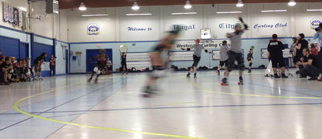 The Goal of a Roller Speed Skating Workshop: To be a blur on the track. Photo features a Terminal City Roller Girl during a bout in July.