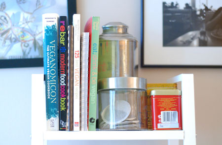 Cookbooks, kept standing with the help of my tea canisters? I may be a genius.