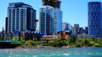 The Simmons Building and two new condo developments in East Village, as viewed from the Tip of St. Patrick's Island.